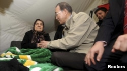 U.N. Secretary-General Ban Ki-moon, second from left, chats with Syrian refugee woman at camp in Islahiye, Gaziantep province, Turkey, Dec. 7, 2012.