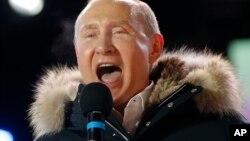 Le président russe Vladimir Poutine à Moscou, le 18 mars 2018.
