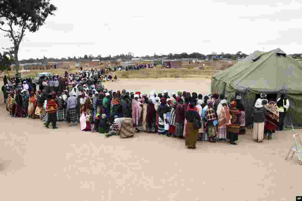 Zimbabweans wait to cast their votes in presidential and parliamentary elections in Harare.