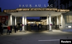 Members of the media stand outside the Baur au Lac hotel where Swiss police arrested FIFA officials, in Zurich, Switzerland, Dec. 3, 2015.