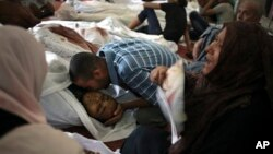 Egyptians mourn over the bodies of their relatives in the El-Iman mosque, Thursday, Aug. 15, 2013.