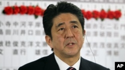 Japan's main opposition leader Shinzo Abe of the Liberal Democratic Party answers a reporter's questions at the party headquarters in Tokyo, Dec. 16, 2012.