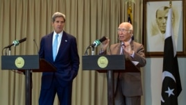 U.S. Secretary of State John Kerry listens as Sartaj Aziz (R), Pakistan's foreign policy chief, speaks during a joint news conference in Islamabad August 1, 2013.