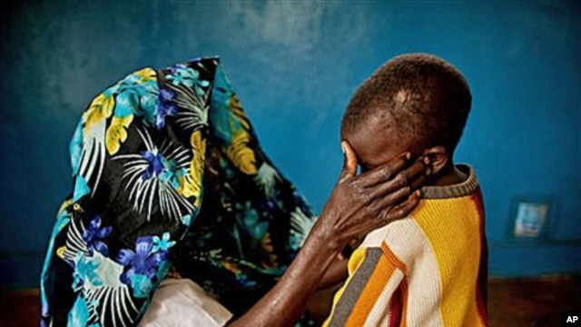 A mass rape victim comforts her son in the town of Fizi, Congo, February 20, 2011