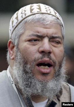 Muslim cleric, Abu Hamza al-Masri, leads prayers at the North London Central Mosque in Finsbury Park in this February 7, 2003 photograph.