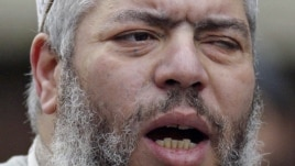 Muslim cleric, Abu Hamza al-Masri, leads prayers at the North London Central Mosque in Finsbury Park, February 7, 2003.