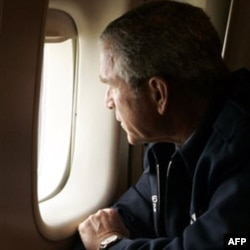 President Bush looks out the window of Air Force One over New Orleans, to inspect the damage from Hurricane Katrina