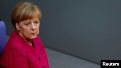 FILE - German Chancellor Angela Merkel during a debate in the lower house of parliament, the Bundestag, in Berlin, Sept. 1, 2014.