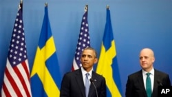 President Obama and Swedish Prime Minister Frederik Reinfeldt talked to reporters in Stockholm