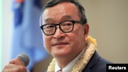 FILE - Cambodian opposition leader Sam Rainsy delivers a speech to members of the Cambodia National Rescue Party (CNRP) at a hotel in metro Manila, Philippines June 29, 2016.