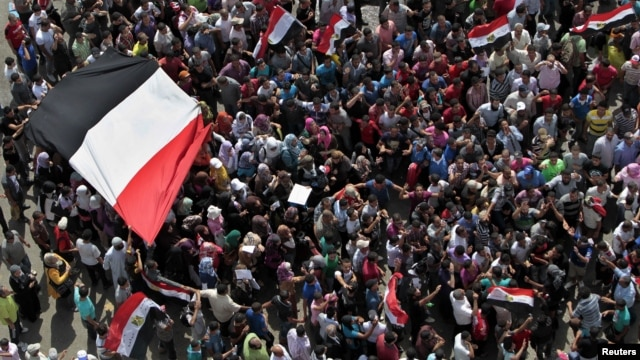 Protesters demonstrate at Tahrir Square in Cairo, Egypt, a day after a court sentenced deposed president Hosni Mubarak to life in prison, June 3, 2012.