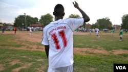 In this June 28, 2012 photo, a footballer for the new South Sudan national team wears a brand new shirt as the country prepares to play its first match around its first anniversary on July 9.