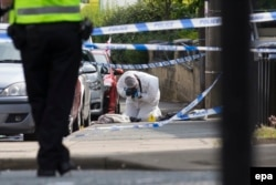 A crime scene investigator works at the scene where Jo Cox was murdered on Thursday.