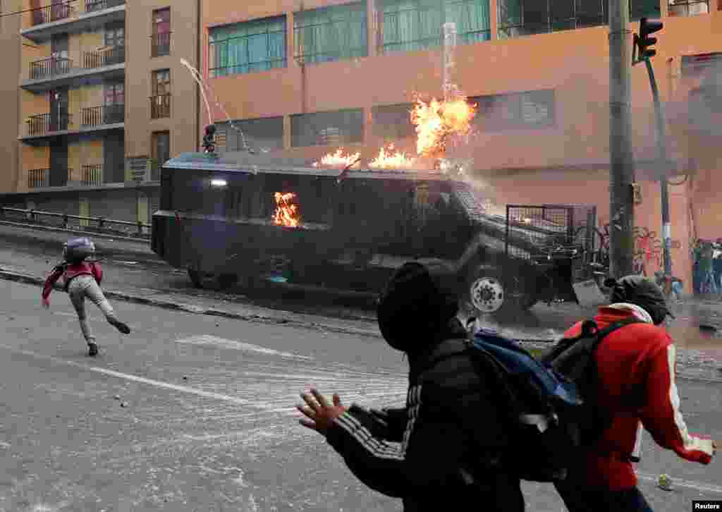 A police vehicle burns during a protest against Ecuador's President Lenin Moreno's austerity measures in Quito, Oct. 7, 2019.