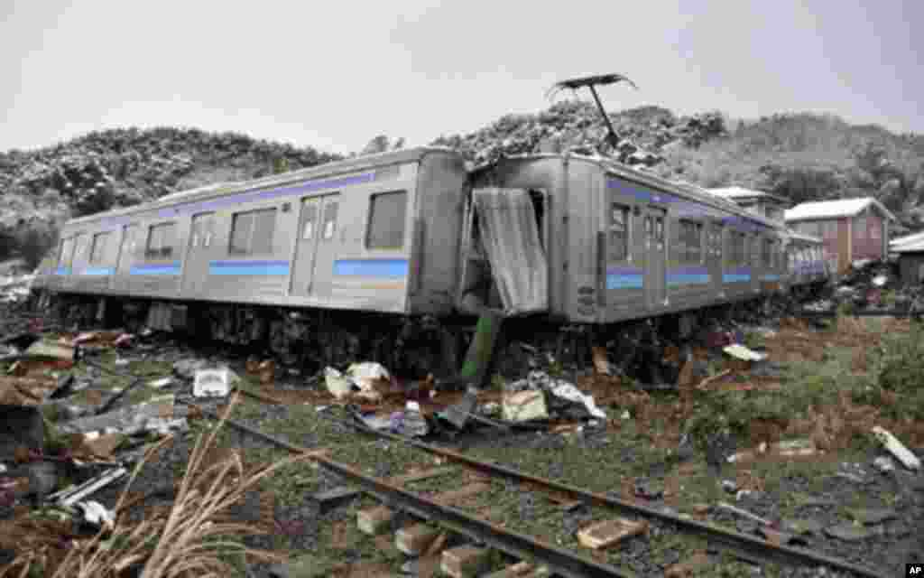A damaged train is seen after an earthquake and tsunami in Matsushima City, Miyagi Prefecture March 12, 2011.