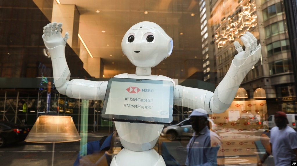 HSBC Bank welcomes SoftBank Robotics' humanoid robot, Pepper, to their team at the Fifth Ave branch on Monday, June 25, 2018 in New York. (Mark Von Holden/AP Images for HSBC)