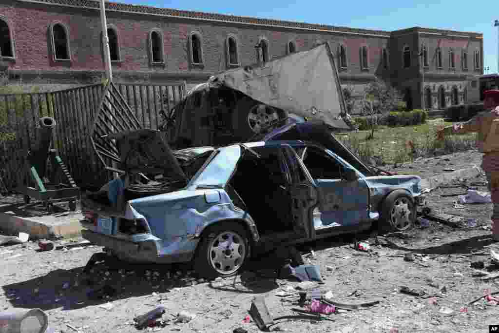 This photo provided by Yemen's Defense Ministry shows damaged vehicles after an explosion at the Defense Ministry complex in Sana'a, Dec. 5, 2013.