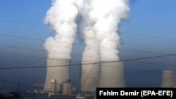 BOSNIA-HERZEGOVINA -- A general view of emissions rising from chimneys of a coal fired thermal power plant in Tuzla, December 12, 2018