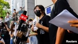 Hang Tung Chow, vice chairwoman of the Hong Kong Alliance in Support of Patriotic Democratic Movements of China, arrives at police headquarters in response to a National Security Department request regarding allegations of foreign agents, in Hong Kong, Sept. 7, 2021.