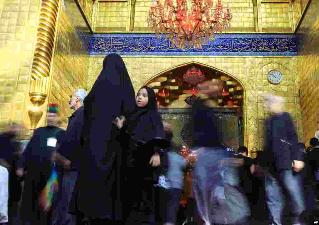 Shi'ite worshippers enter the holy shrine of Imam Abbas, brother of Imam Hussein, during Muharram in Karbala, Iraq, Nov. 12, 2013.