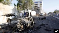 Wreckage of cars is seen outside the Jazeera Hotel, in Mogadishu, Somalia, Jan. 2, 2014.