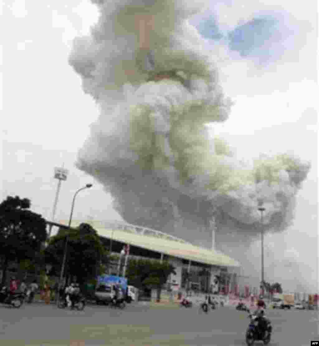 In this Wednesday, Oct. 6, 2010 photo, a giant column of smoke billows over the sky after fireworks intended for upcoming Hanoi's 1,000th birthday celebration exploded in Hanoi.