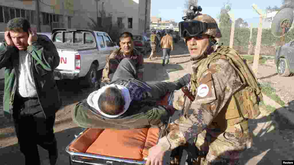 A wounded man is transported on a stretcher to receive treatment after a suicide attack in Kirkuk, 250 kilometers north of Baghdad, January 16, 2013.