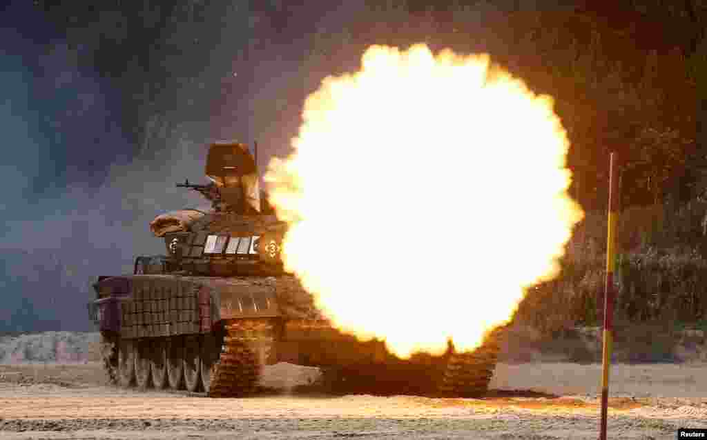 A T-72B1 tank fires during the Safe Route competition at the International Army Games 2017 at the Andreyevsky military polygon outside Tyumen, Russia.
