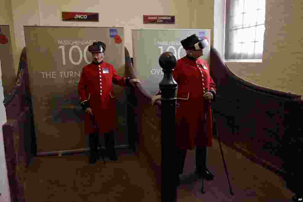 "Chelsea pensioners John Kidman, 87, right, and Bill ""Spud"" Hunt, 83, wear virtual reality headsets during an exhibition at the Household Cavalry Museum in London."