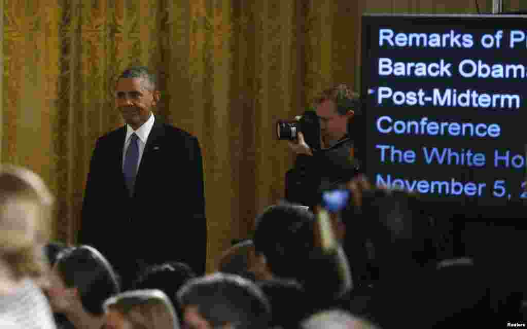U.S. President Barack Obama arrives for a news conference in the East Room of the White House in Washington, Nov. 5, 2014.