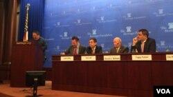 何志平在美国传统基金会举办的座谈会上讲话。(2015年12月9日)