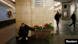 A man reacts next to a memorial site for the victims of a blast in St. Petersburg metro, at Tekhnologicheskiy institut metro station in St. Petersburg, Russia, April 4, 2017.