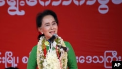 FILE - Myanmar's opposition leader Aung San Suu Kyi speaks during an election campaign for her National League for Democracy party, Sept 27, 2015.