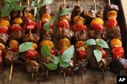 FILE - South African beef and apricot sosaties (kebabs) are seen in a photo illustration. Dishes with a variety of ethnic flairs served in communal food halls have become the latest craze in New York and other U.S. cities.