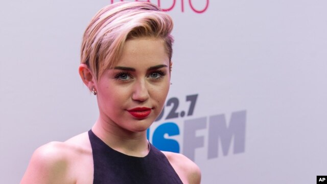 Miley Cyrus arrives at the KIIS 102.7 Jingle Ball held at the Staples Center in Los Angeles, California, Dec., 6, 2013.