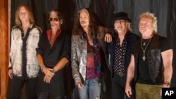 FILE - From left, Tom Hamilton, Joe Perry, Steven Tyler, Brad Whitford and Joey Kramer of the rock band Aerosmith attend a photo call in Munich, Germany, May 25, 2017.