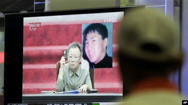 A South Korean man in Seoul watches a TV news program showing North Korean leader Kim Jong Il as he appointed youngest son, Kim Jong Un - shown in portrait at top right - as an army general in an apparent sign he is being groomed as country's next leader,