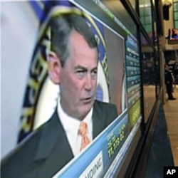 US Rep. John Boehner, R-Ohio, is seen on a television screen on the floor of the New York Stock Exchange, 03 Nov 2010