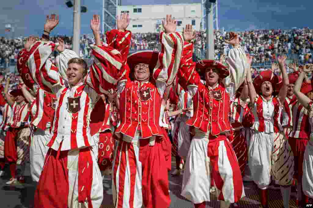 Performers react during celebrations of the Swiss National Day at the Fete des Vignerons (Winegrowers' Festival), a traditional festival which takes place approximately every 25 years in Vevey, western Switzerland.