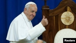 Pope Francis gestures to prisoners at Curran-Fromhold Correctional Facility in Philadelphia, Sept. 27, 2015.