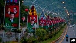 شهر اسلام آباد با عکس های رهبران چین و پاکستان مزین شده بود