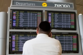 A departure flight board displays various cancelled and delayed flights at Ben Gurion International Airport a day after the U.S. FAA imposed a 24-hour restriction on flights, in Tel Aviv, July 23, 2014.