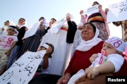 Yazidi women cry as they attend a demonstration at a refugee camp in Kurdish-dominated city of Diyarbakir, Turkey, to mark the second anniversary of what a U.N.-appointed commission of independent war crimes investigators termed a genocide against the Yazidi population by the Islamic State, Aug. 3, 2016.
