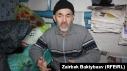 FILE - Human rights advocate Azimjan Askarov is seen in Prison #47 in Bishkek, Kyrgyzstan, Dec. 28, 2011. Askarov is serving a life sentence for what critics say were trumped up charges.