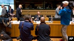 Greek Finance Minister Yanis Varoufakis, center, is photographed during a round table meeting of European Union finance ministers at the European Council building in Luxembourg, June 19, 2015.