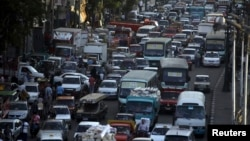 Cars are held up in a traffic jam in downtown Cairo, September 2013.