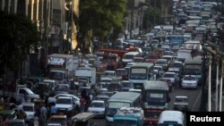 FILE - Cars are stuck in a traffic jam in downtown Cairo, September 2013.
