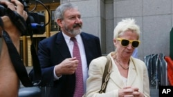 Jonathan Blackman, left, a lawyer representing Argentina, leaves federal court in New York, July 22, 2014.