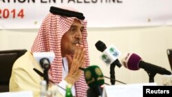 FILE - Then-Saudi Foreign Minister Prince Saud al-Faisal addresses a news conference following a meeting of the Organization of Islamic Cooperation in Jeddah, Aug. 12, 2014.