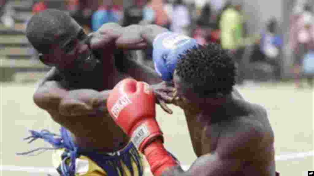 Bahago Yellow of Maiduguri state, left, fights with Bahago Balgori of Kaduna state, right, in the 65 Kg bout in the traditional Nigerian boxing ''Dambe'' contest.